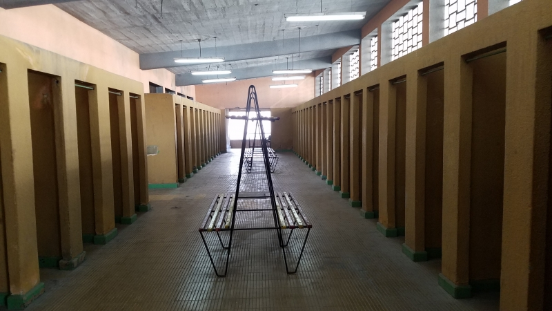 bench and stalls with tiled floor