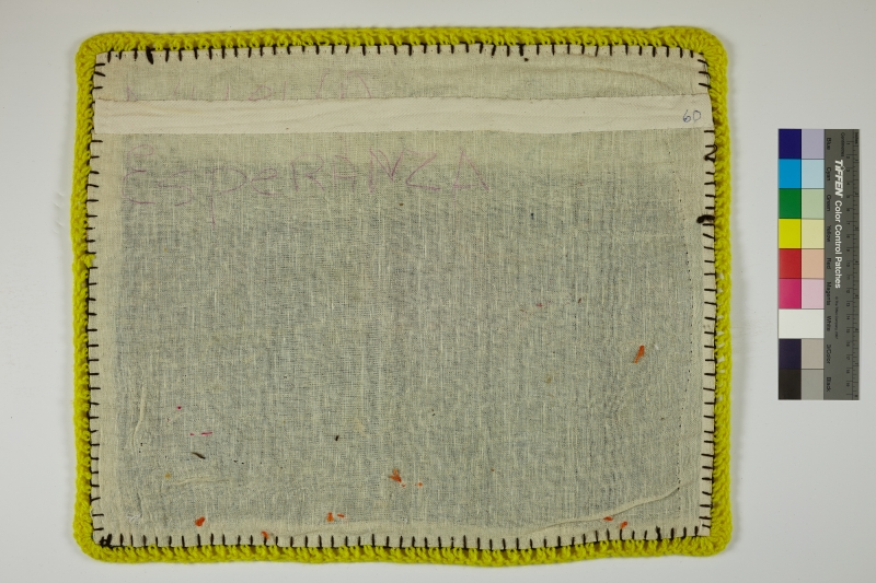 The back of an Arpillera lined with yellow yarn