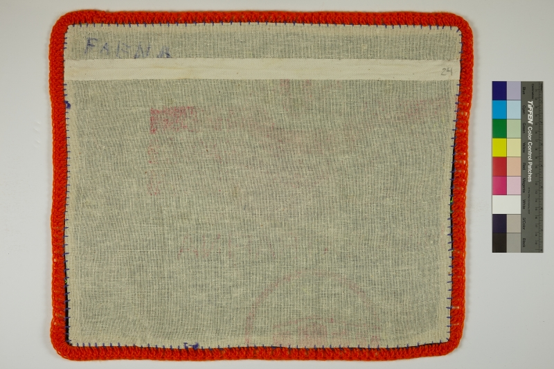 The back of an Arpillera lined with red yarn