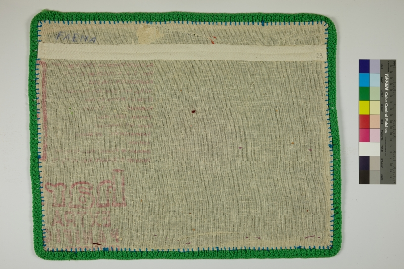 The back of an Arpillera lined with green yarn