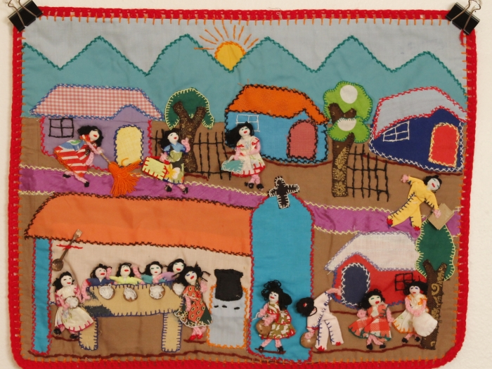Depicting general life for mainly the female population in a village.