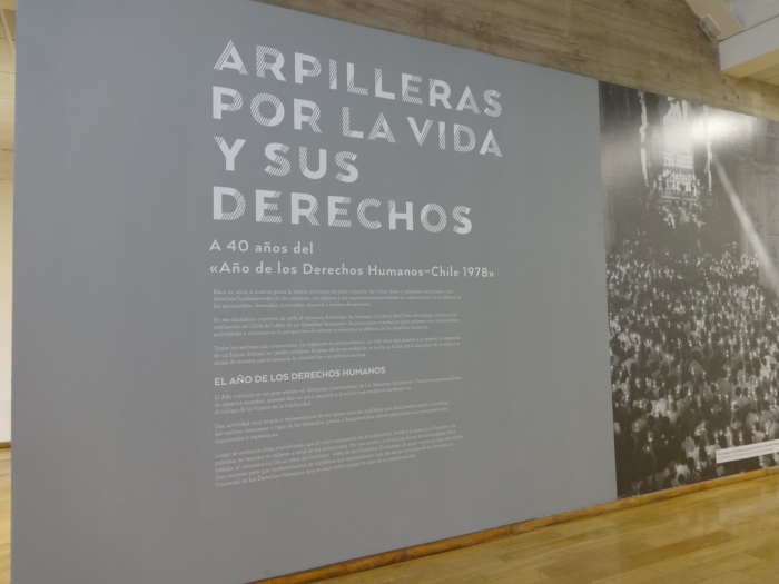 large text panel on arpillera exhibit