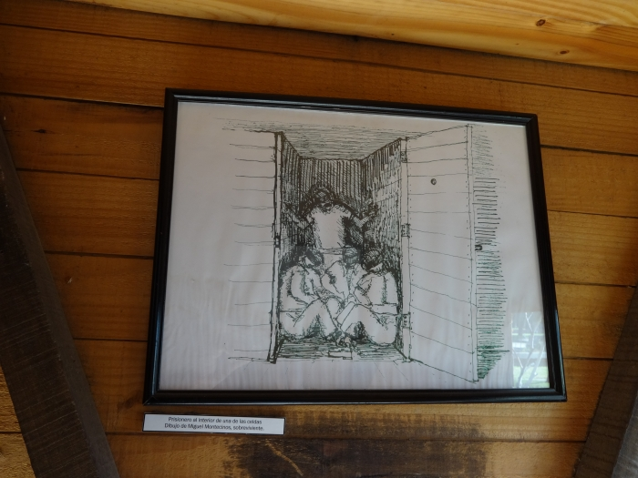 photo of drawing of prisoners confined to small shack